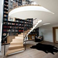 spiral-staircase-with-a-beautiful-bookcase-wall - Home Decorating Trends - Homedit Farmhouse Renovation, Modern Farmhouse Kitchens, Farmhouse Kitchen Decor, Bungalow, Bespoke Staircases, Spiral Staircases, Bookcase Wall, Library Bookshelves, Bookcases