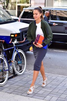 Jessica Alba in By Johnny skirt and jacket, Tory Burch purse, an Nicholas Kirkwood shoes