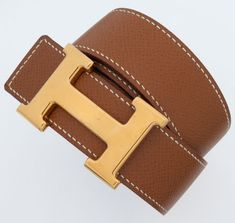 Hermes Gold Clemence Leather & Black Calf Box Leather Reversible Constance H Belt with Gold Hardware This - Available at Tuesday Internet Luxury. Hermes Bags, Hermes Handbags, Hermes Belt Women, Hermes Belt Outfit, Women Accessories, Fashion Accessories, Luxury Belts, Designer Belts, Brown Belt