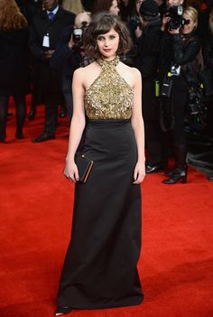 """Red Carpet Watch: Felicity Jones - NYTimes.com Going halfsies: a glittery bodice was mitigated by a long black skirt at the London premiere of """"The Invisible Woman"""" in January. (Photo: Ian Gavan/Getty Images)"""