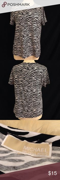 Michael Kors Zebra Print Top Bust 40 Length 24 This top is in excellent condition. no stains, rips, or holes. The size tag is missing, but other than that it is like New. Michael Kors Tops Tees - Short Sleeve