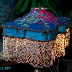 "Victorian lampshade, ""Katie"" shape in vintage blue beaded silk sari fabric, hand dyed lace, overlay and braid, with colour-enhancing lining."