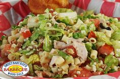 Chicago Chopped Salad.  Smoked chicken, chopped bacon, chopped romaine, blue cheese, green onion, diced tomato, and ditalni pasta, all tossed in our honey mustard vinaigrette.  Served with honey-kissed cornbread.
