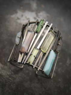 "Delphine Nardin - Cuff- Palladium plated- brass, semi-precious stones. Bracelet ""Graphic"" Laiton plaqué au palladium et cabochons de pierres fines 2009"