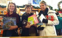 Holiday shoppers buying books for Helpline House.