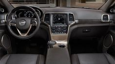 """2014 Jeep® Grand Cherokee Summit shown with Natura Plus leather-trimmed interior shown in """"Madagascar"""" Jeep Brown."""
