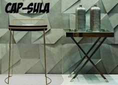 Cap-sula è uno sgabello con struttura in tondino di ferro verniciato e seduta i legno. La struttura nella parte superiore va oltre il piano della seduta e forma la maniglia/schienale. Lo sgabello cap-sula, a necessità può anche essere utilizzato come tavolino.  Cap-sula è un oggetto versatile, semplice, formato da due materiali opposti, metallo con finitura verniciata, liscia ,colorata e il legno con finitura naturale, ruvida.