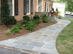 Stone walkway in the front yard #landscaping
