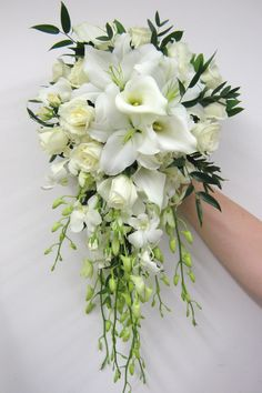 bridal bouquet was a classic cascade style and included orchids