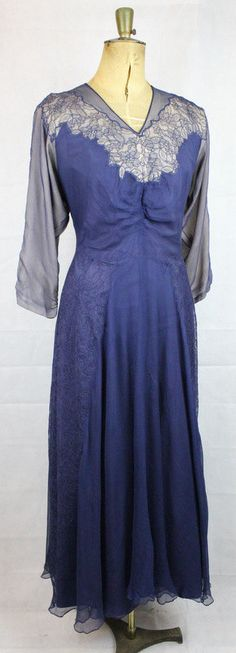 Frédérique Original 1940s Navy Blue Silk & Lace Gown  This original 1940s navy blue silk dress with lace accents and a nude underlayer is