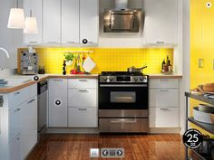 Stylish IKEA Kitchen Design Ideas 2012 : Admirable Yellow and White IKEA Kitchen with Yellow Ceramic Tiles Backsplash and Wooden Floor