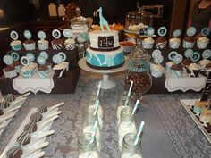 Safari Baby Shower {Boy Baby Shower} -     This safari themed baby shower gets a fun and modern twist with this AMAZING blue and brown dessert table!  Giraffe and zebra print cupcake wrappers and toppers join personalized tags for a special touch.  The jars of milk with blue and white striped straws are fabulous!