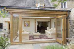 Oak framed orangery with a flat roof featuring a glazed lantern allowing natural light to flood the room. The bi-fold doors allow for truly indoor-outdoor living. Pergola With Roof, Patio Roof, Pergola Kits, Diy Pergola, Pergola Ideas, Pergola Plans, Roof Ideas, Wooden Pergola, Patio Ideas