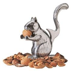 """RSVP Nutty Squirrel Nutcracker is an unique 5 3/4"""" squirrel shape metal nut cracker. Place nut in squirrel's mouth then lift his tail to close his mouth and crack the shell."""