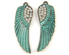 Hey, I found this really awesome Etsy listing at https://www.etsy.com/listing/500578515/angel-wing-earring-findings-verdigris