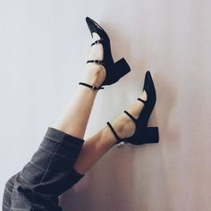 Let your footwear take centre stage in these black leather multi buckle mid shoes featuring a block heel and pointed toe. Add to your work wear wardrobe for vamp-ish style. #Topshop