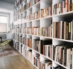 Built In Bookcase - A grid of white shelves filled with books White Shelves, Bookshelves Built In, Built Ins, Bookcases, Book Shelves, Bookshelf Ideas, Book Storage, Wall Shelves, Living Room New York