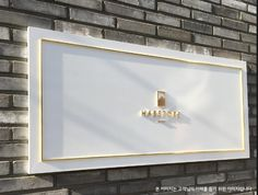 THis white board with gold for my sign behind my front desk is what I am looking for. It doesn't have to be this large Signage Board, Wayfinding Signage, Signage Design, Cafe Design, Showroom Interior Design, Gold Interior, Cafe Interior, Corporate Signs, Sign Board Design
