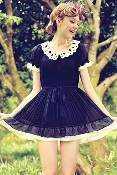 This dress crafted in chiffon, featuring contrast colored edge design, cut-away peter pan collar, short sleeves with elastic cuff, pleated design of skirt, in medium length cut. A matching chiffon belt is available.$81