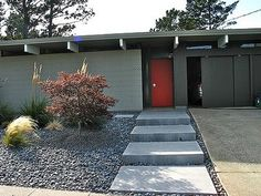 love the door color and the concrete steps to the front door