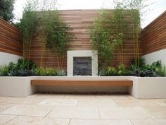 We created a new rear garden courtyard space for a young couple living in Fulham, London, to reflect their stylish interior decorating style.