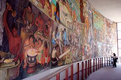 """This photo captures the immensity of Rivera's """"Pan American Unity"""" mural, but the perspective still does not show the entire work. Measuring 22 feet high by 74 feet long, the fresco mural is painted on 10 steel-framed panels that were bolted together, allowing the entire painting to be dismantled and moved. Altogether the massive painting weighs 23 tons. Photograph by Mark Vallen ©"""