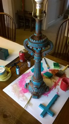 I painted this lamp a burnt sienna and then brushed turquoise over it, which kind of made it look like a bronze with patina