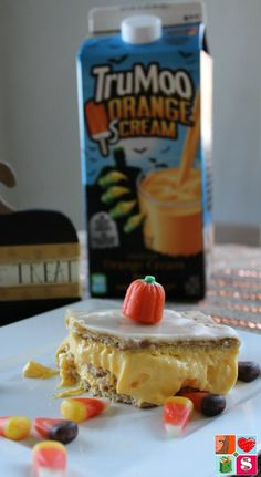 Candy Corn Inspired Eclair Cake Recipe from Having Fun Saving and Cooking.