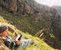 "Mark McTaggart on Instagram: ""Relaxing in the sun, enjoying a good book with an incredible view. Mponjwane Cave, Drakensberg, South Africa. #Drakensberg #kindle #reading #sunshine #mnweni #mponjwane #wunderlust #explore #travel #instagood #instanature #autumn #africa #adventure #southafrica #drakensbergmountains #drakensbergadventures #hiking #hikingadventures #kwazulunatal #kzn #mountains #book"""