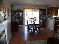 Dining room overlooking a deck, lawns in a townhouse condo for sale. West Boylston MA
