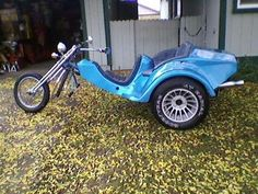 Built 1974 two seater, two passenger VW trike motorcycle with a 1200cc motor, a springer front-end and a metallic blue paint color. The 1974 VW Trike Motorcycle for Sale is a two seater that has been garaged for 20 (?) years and yes, it does need some TLC.   The 1974 (ish) VW two passenger