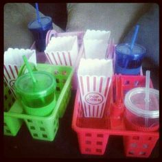 Dollar Tree movie caddies! Use shower caddies, popcorn containers, and cups with straws from Dollar Tree to make epic snack carrying caddies for movie nights!