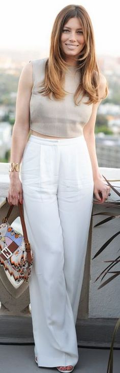 Who made  Jessica Biel's beaded handbag, gold jewelry, white pants, and tan top?