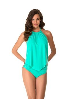 Magicsuit By Miraclesuit Solid Green Nicole Tankini Underwire Top. This swimwear top is solid pistachio green with a shelf bra, underwire, tummy control, and halter top style. The halter top on this bathing suit ties at the back of the neck. Fashion forward body control swimwear for a modern women. Appear sleek & slimmer in seconds. Mix and match swimwear. Each piece is sold separately. Style # 475669. Magicsuit By Miraclesuit Solid Nicole Tankini Underwire Top.