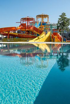 Euphoria Resort, Chania, Crete, Greece - In a specially designed area, supervised by trained personnel, kids can find exciting games to exhaust their energy, make new friends, laugh and enjoy their vacation. Top-of-the-range water slides (4 fast slides) fulfilling all safety measures and a huge swimming pool are the ultimate entertainment for your family. Waterfalls and adventurous towers are the magical scenery for kids and adults, to experience magnificent moments. In the waterpark you can… Waterparks Band, Water Slides, Make New Friends, Fun Activities, Swimming Pools, Waterfall, Scenery, Water Parks, Crete Greece