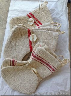 Mini Grain Sack Stockings..these could be made out of the inexpensive dish towels or cloths  from Dollar Tree.
