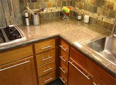 granite tile countertops with bull nose edge- we just found tile close to this.