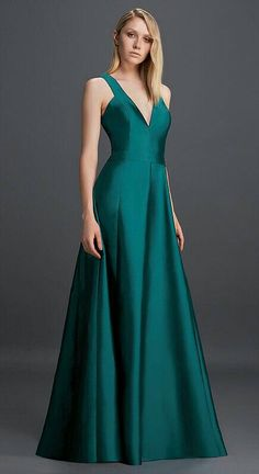 Like the clean lines, but not a fan of the top half. Maybe change the straps to off the shoulder, but keep it a v-neckline. Change the color from jade to maybe a coral color, possibly a navy blue?
