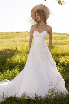 Watters Bridal  Style: Malibu  Embroidered lace, white silk taffeta, and washed silk organza strapless dress with delicate flowers and embroidered leaves on bodice and cover buttons at back wait band, chapel trail