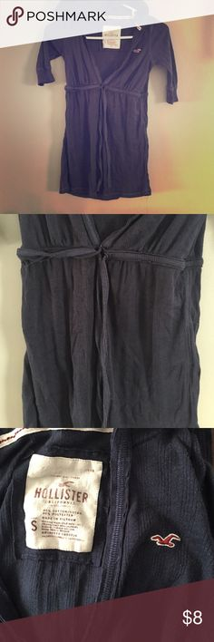 Women's Hollister Tee Women's Hollister Tee size S. Good, shirt sleeves, tie around the waist. Small defect where Tie on left side at waist can be seen (can see in picture 2) but does not damage the top. Hollister Tops