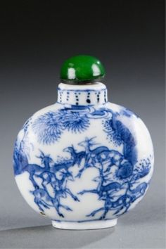 Lot 497: A Chinese porcelain snuff bottle with deer in landscape with pines in blue under glaze. c.1800-1880. Estimate: $400-$600.