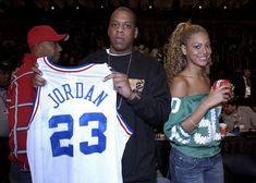 Beyoncé & Jay courtside during the 2003 NBA All-Star game at the Philips Arena in Atlanta on 9th February 2003.