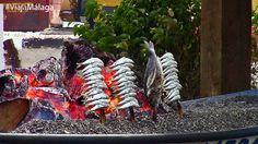 Espetos de sardinas, típicos de Málaga.