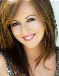 """Lisa Kelly.  She is my singing role model...oh my goodness.  Not only does she have an incredible, beautiful voice, but she sings with such feeling and with such a light in her eyes.  If you don't know what I'm talking about, go look up her singing """"Caledonia"""" on YouTube.  Right now. Yeah."""