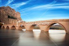 Old bridge under wonderful sky.