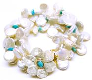 Helga Wagner Fresh Water Pearl Coins and Turquoise chips with  Mother of Pearl flower clasp with Turquoise Cabochon set in 14 K gold.