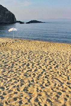 Buy Greek Sandy Beach by on PhotoDune. Sun Umbrella on Greek Beach Sun Umbrella, Summer Vacations, Greek, Stock Photos, Beach, Water, Outdoor, Gripe Water, Outdoors