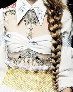 glazed braid, kitten collar, bandeau bra top, & loads of diamonds.
