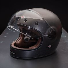 The Retro Metallic Titanium color on this Bell Bullitt Helmet is Vintage styled for any rider who's looking for that Classic Cafe Racer look. Cool Motorcycle Helmets, Racing Helmets, Scrambler Motorcycle, Cool Motorcycles, Vintage Motorcycles, Motorcycle Accessories, Motorcycle Jackets, Motorcycle Style, Guzzi V7