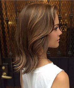 medium brown hairstyle with highlights